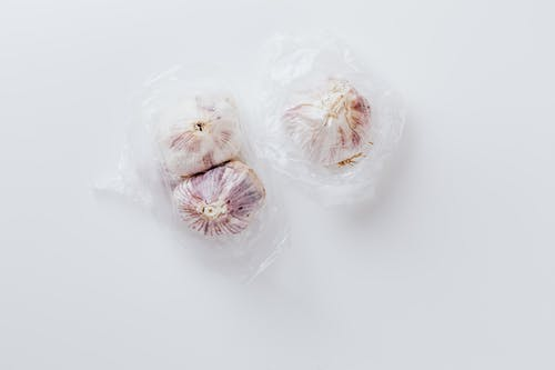 White Garlic on Clear Plastic Bag