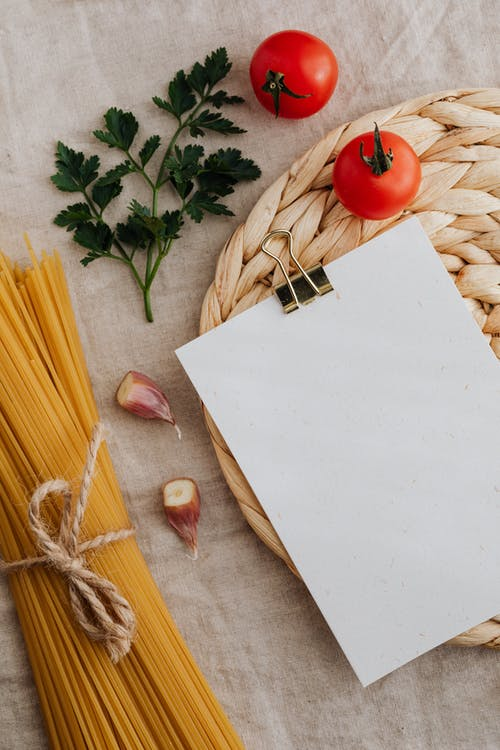 Pasta Noodles Near White Blank Paper