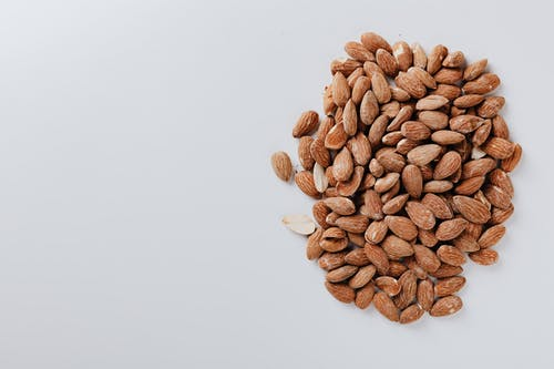 Brown Almonds on White Surface