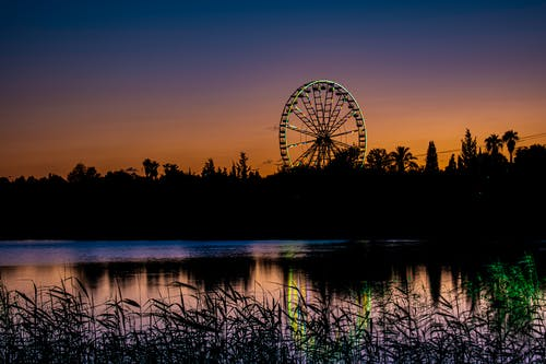 Silhouette of Ferris Wheel during Sunset
