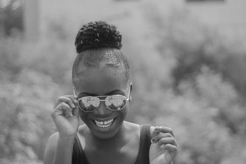 Grayscale Photo of Woman Wearing Sunglasses