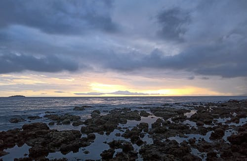 Rocky Shore Under Cloudy Sky