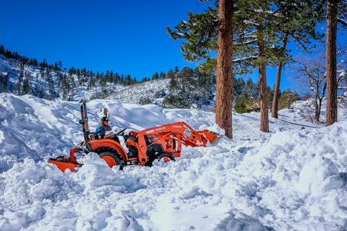 Red Tractor on Snow Covered Ground
