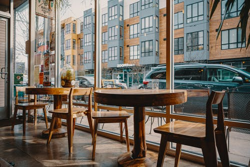 Modern cafe interior in front of building facade in city