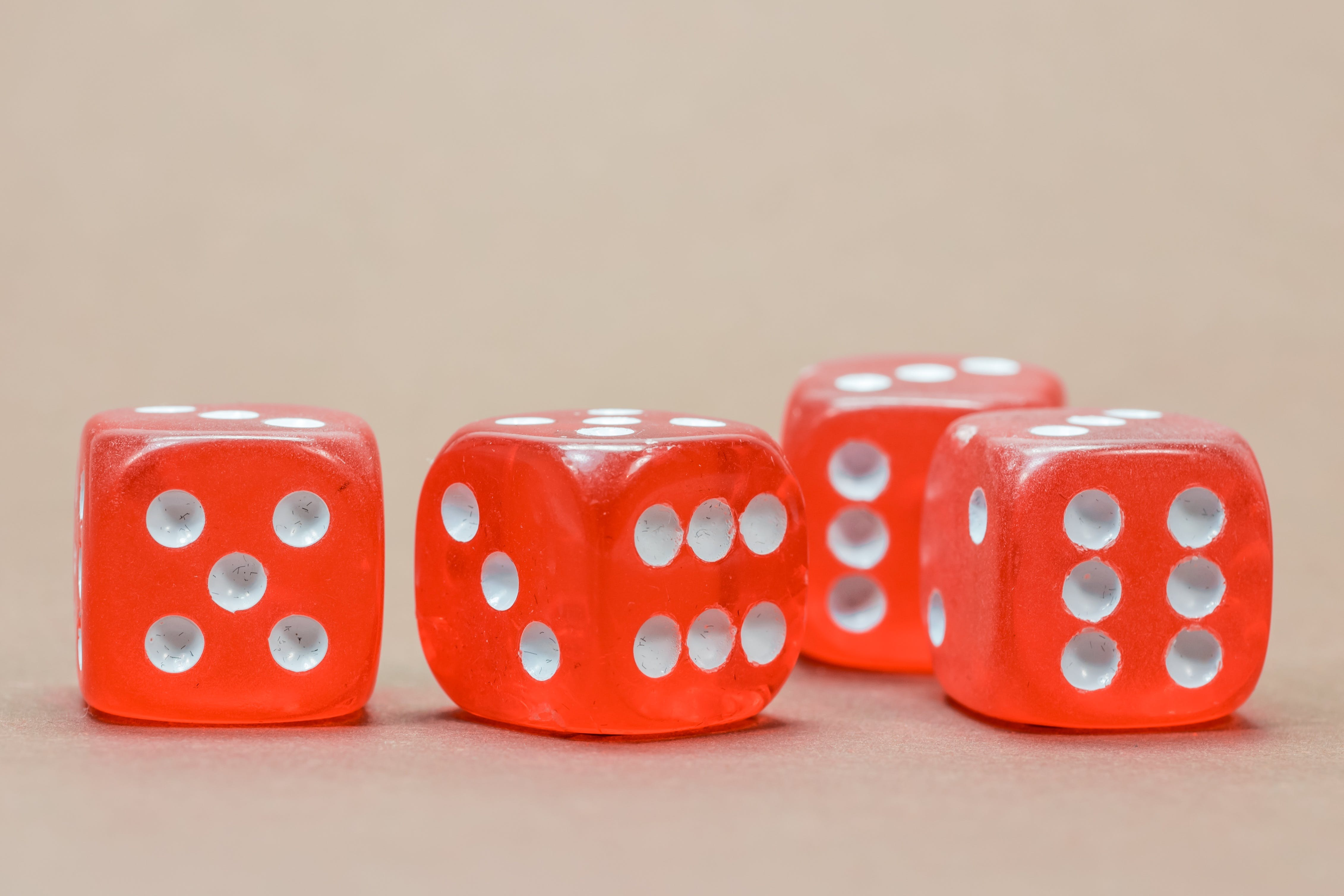 Close Up Photography of 4 Red White Dice