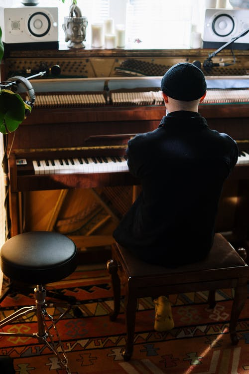 Man in Black Shirt Playing Piano