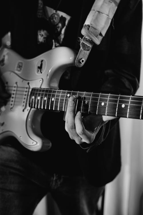 Grayscale Photo of Electric Guitar