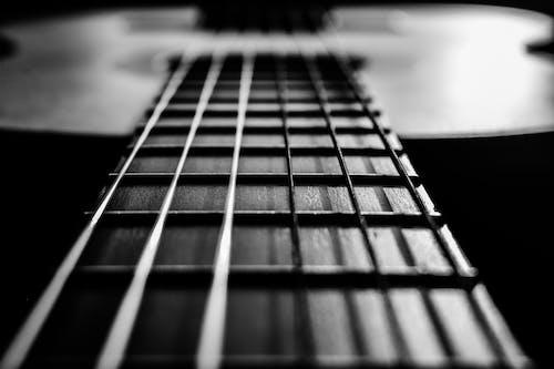 Steel strings of classical guitar in room