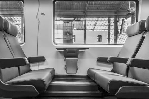 Grayscale Photograph of Vehicle Seats