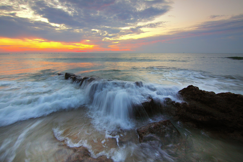 Ocean Wave Under Cloudy Sky