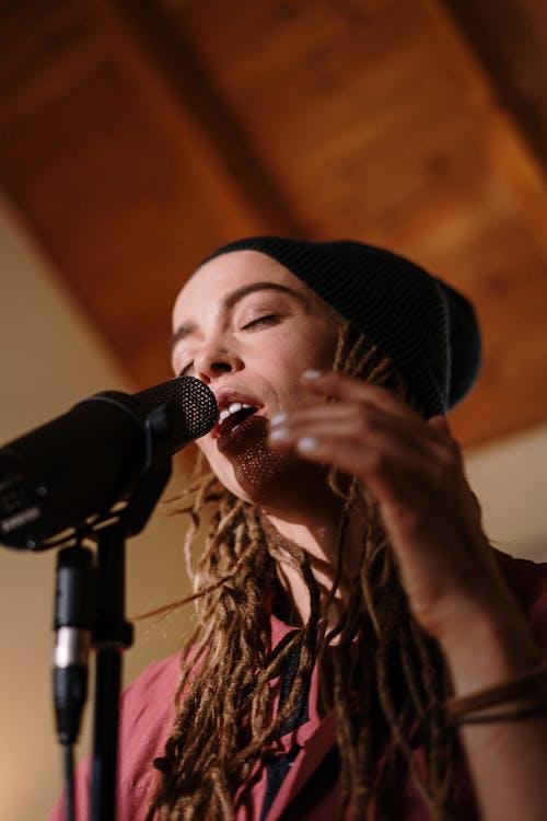 Woman in Black Knit Cap Singing