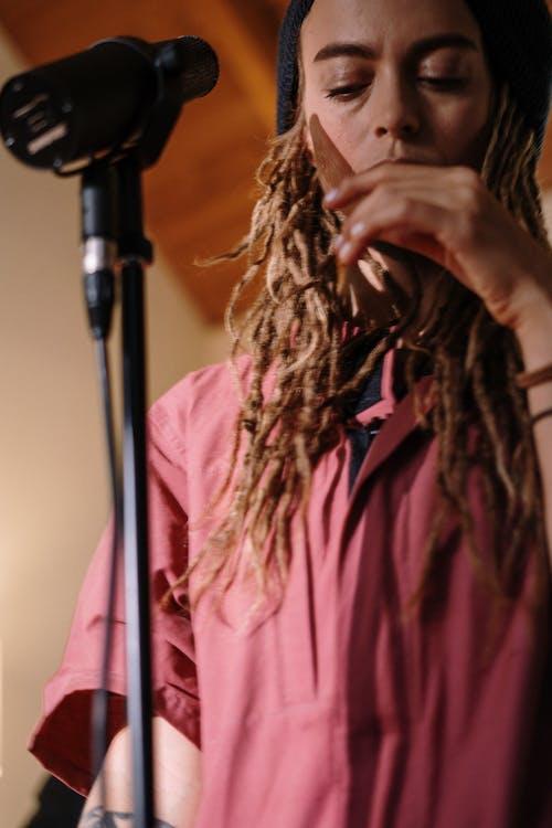 Woman in Pink Shirt Singing