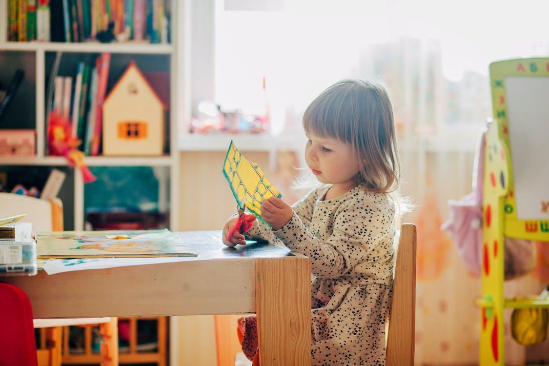 Little Girl Using Scissors