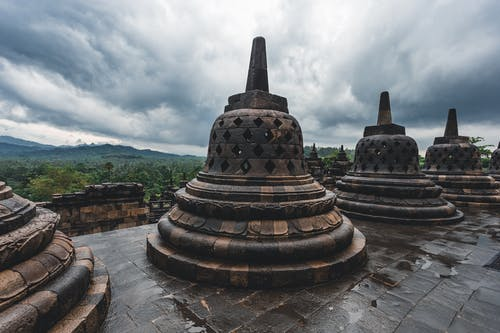 Aged Buddhist temple terrace with bell shaped stupas