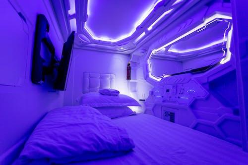Interior of creative illuminated capsule hotel
