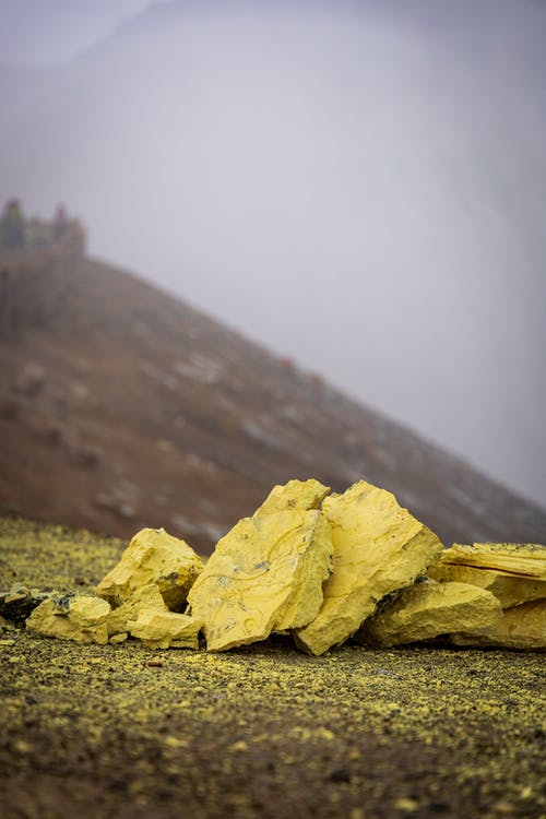 Yellow Rock Formation Under White Sky