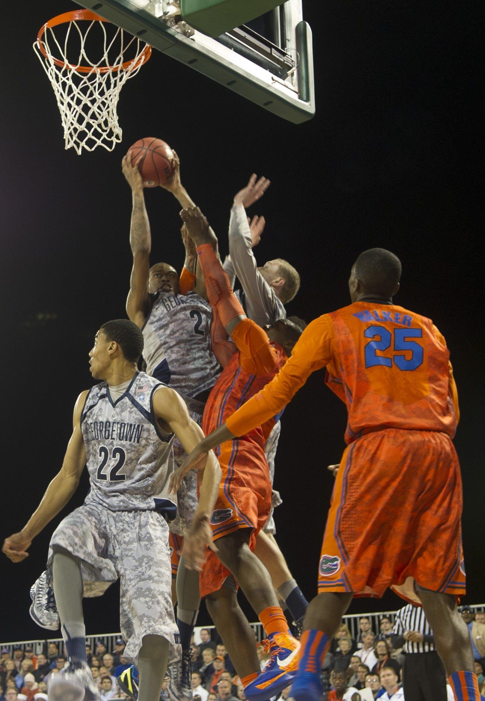 Four Men Playing Basketball