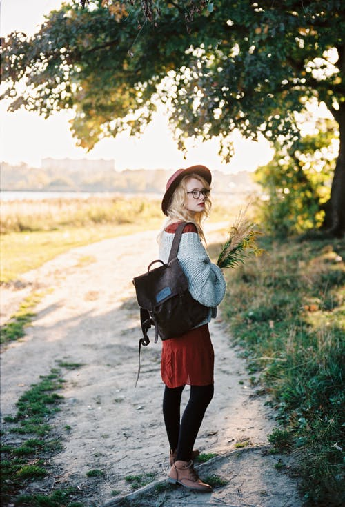 Woman in Gray Sweater Walking Outdoors