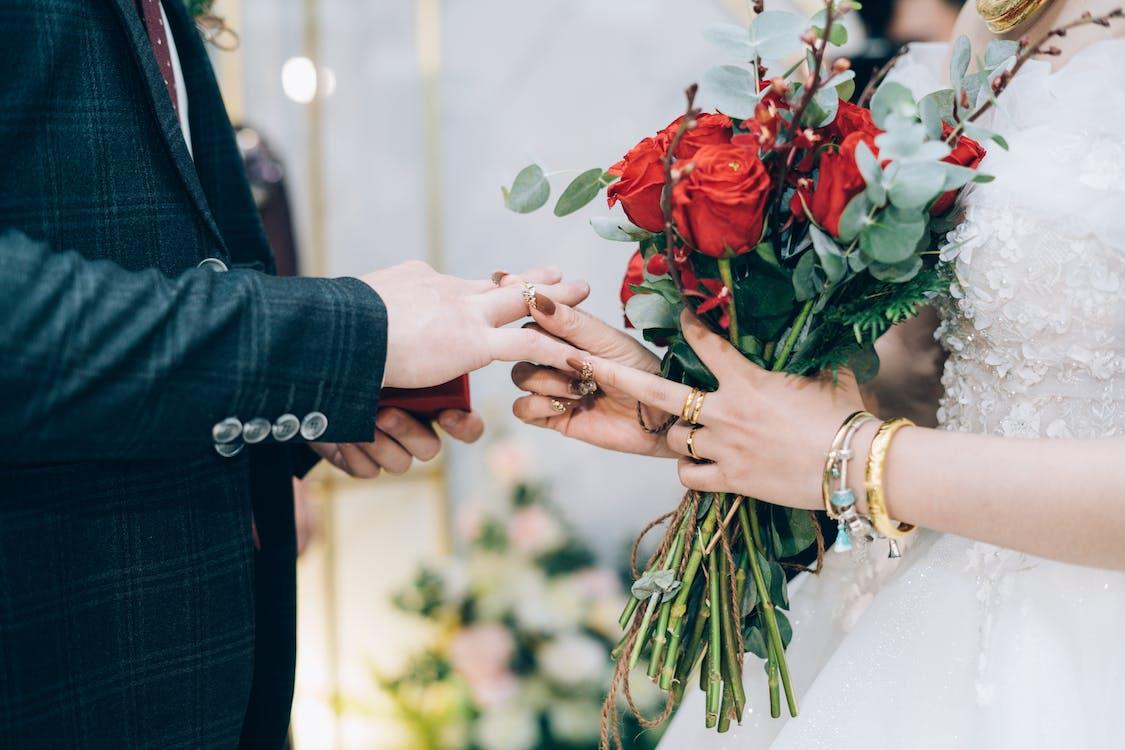 Groom and bride exchanging wedding rings