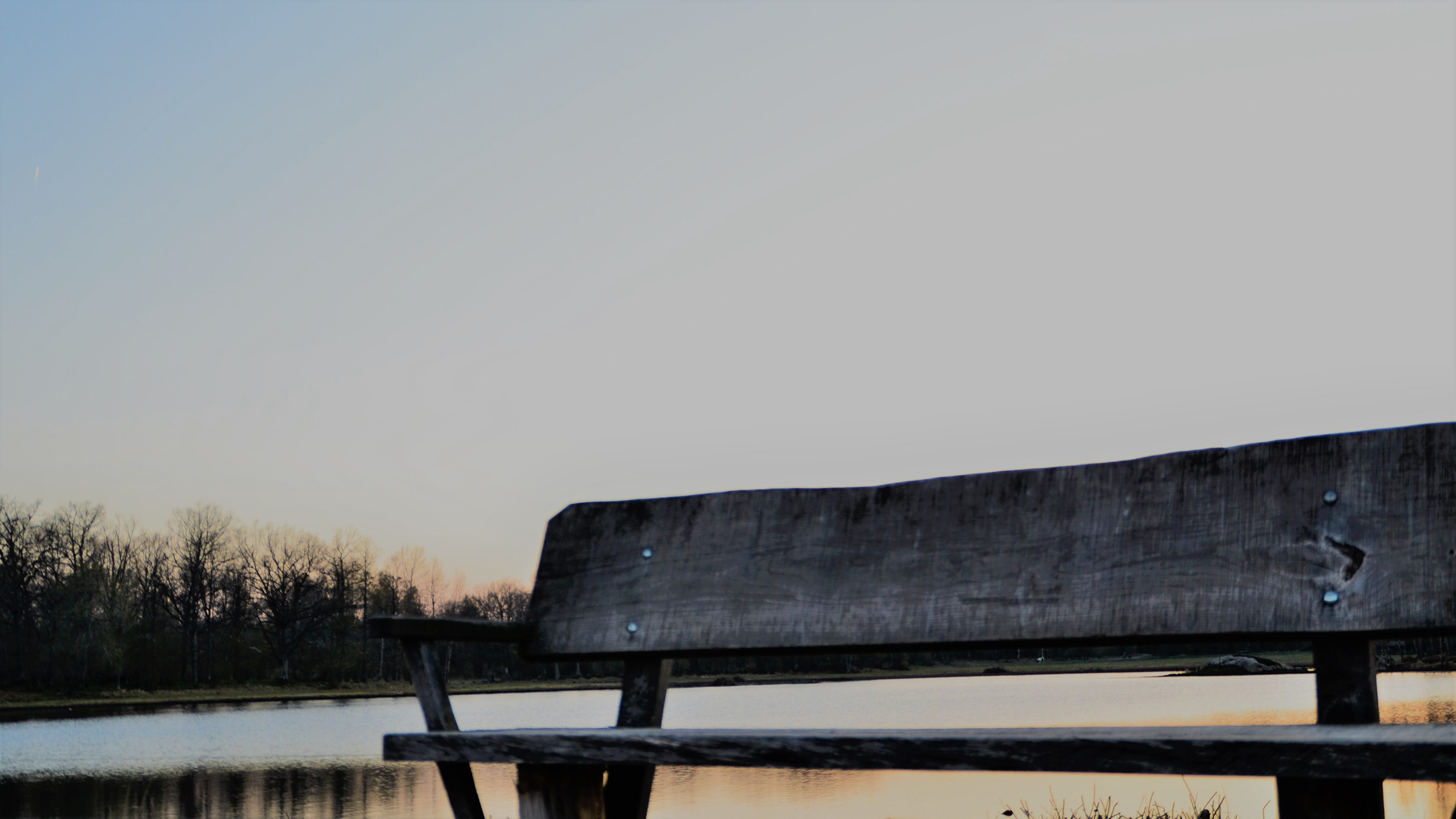 Free stock photo of alone, bench, pond, sunset