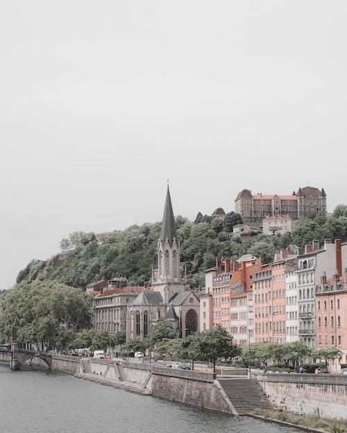 Безкоштовне стокове фото на тему «архітектура, Будівля, вежа, вода»