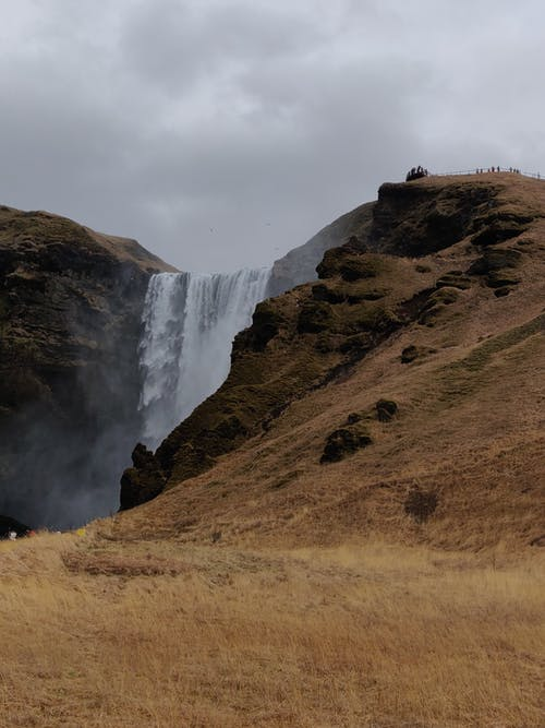 Waterfall in mountains in overcast weather