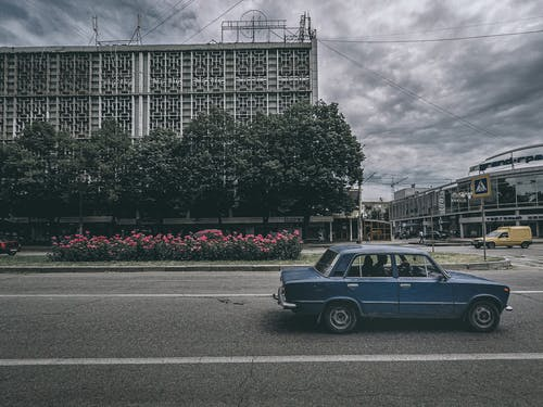 City street under cloudy sky in gloomy day