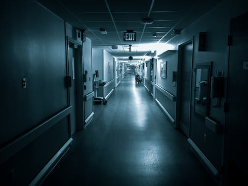 Empty long corridor of modern hospital