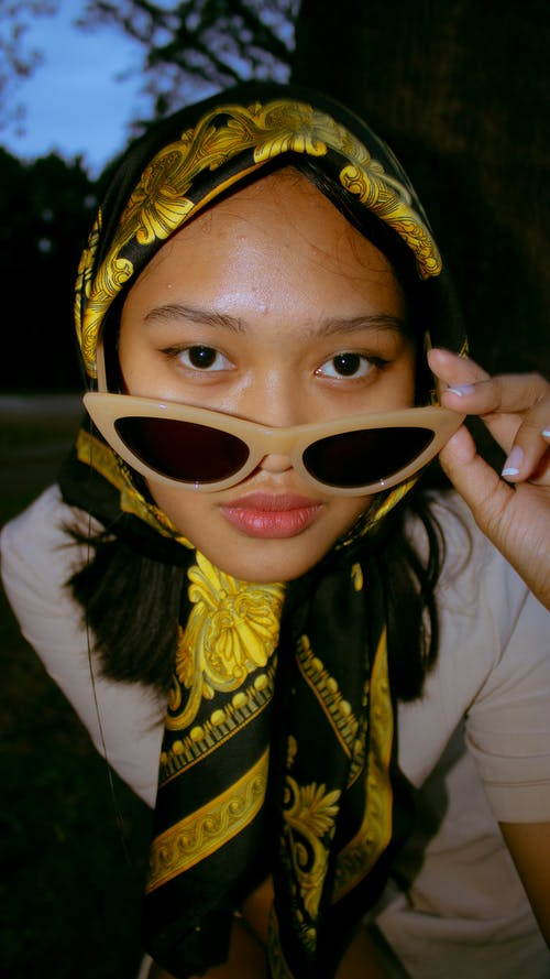 Woman Wearing Gold and Black Headscarf Brown Sunglasses