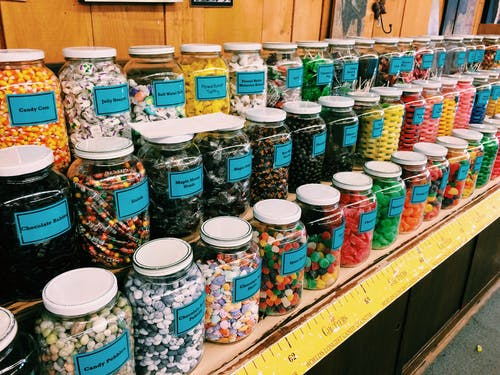 Colorful Sweets in Glass Jars