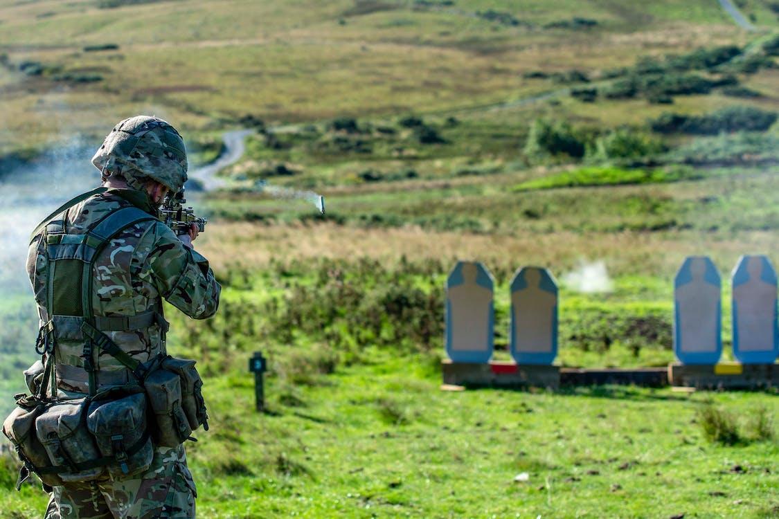 Soldier practicing shooting in outdoor shooting range