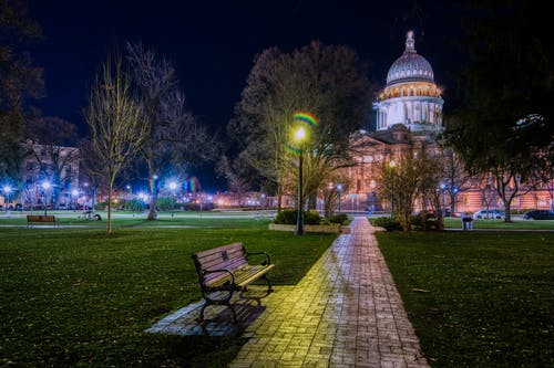 Cold park with benches against cathedral at night