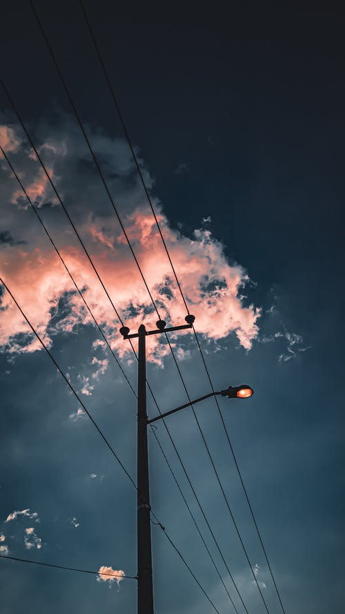 Black Street Light Under Blue Sky and White Clouds