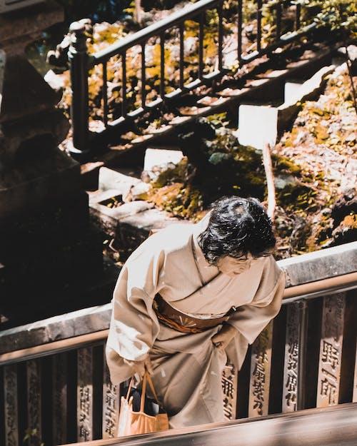 Woman Wearing Beige Kimono