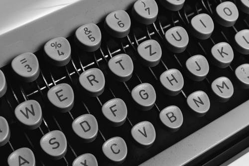 White and Black Typewriter Keyboard