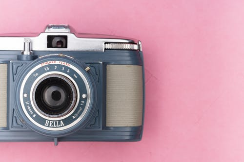 Black and Silver Camera on Pink Surface