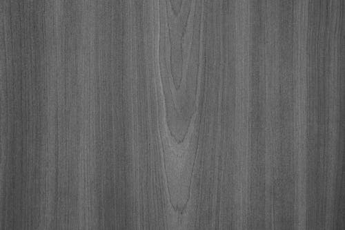 Grayscale Photo of Wooden Surface