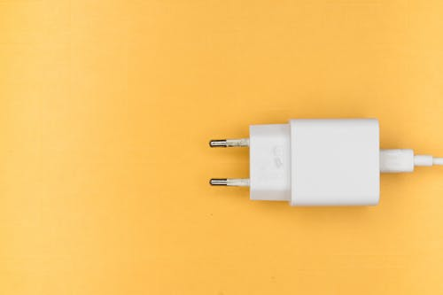 White Adapter on Yellow Surface