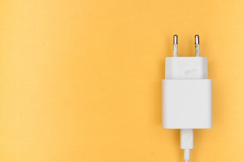 White Adapter on Yellow Wall