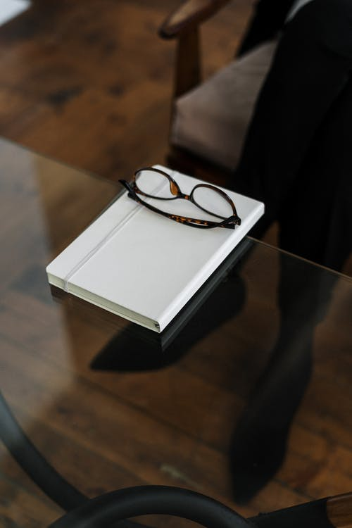 Black Framed Eyeglasses on White Box
