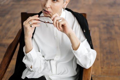Man in White Dress Shirt Holding Eyeglasses