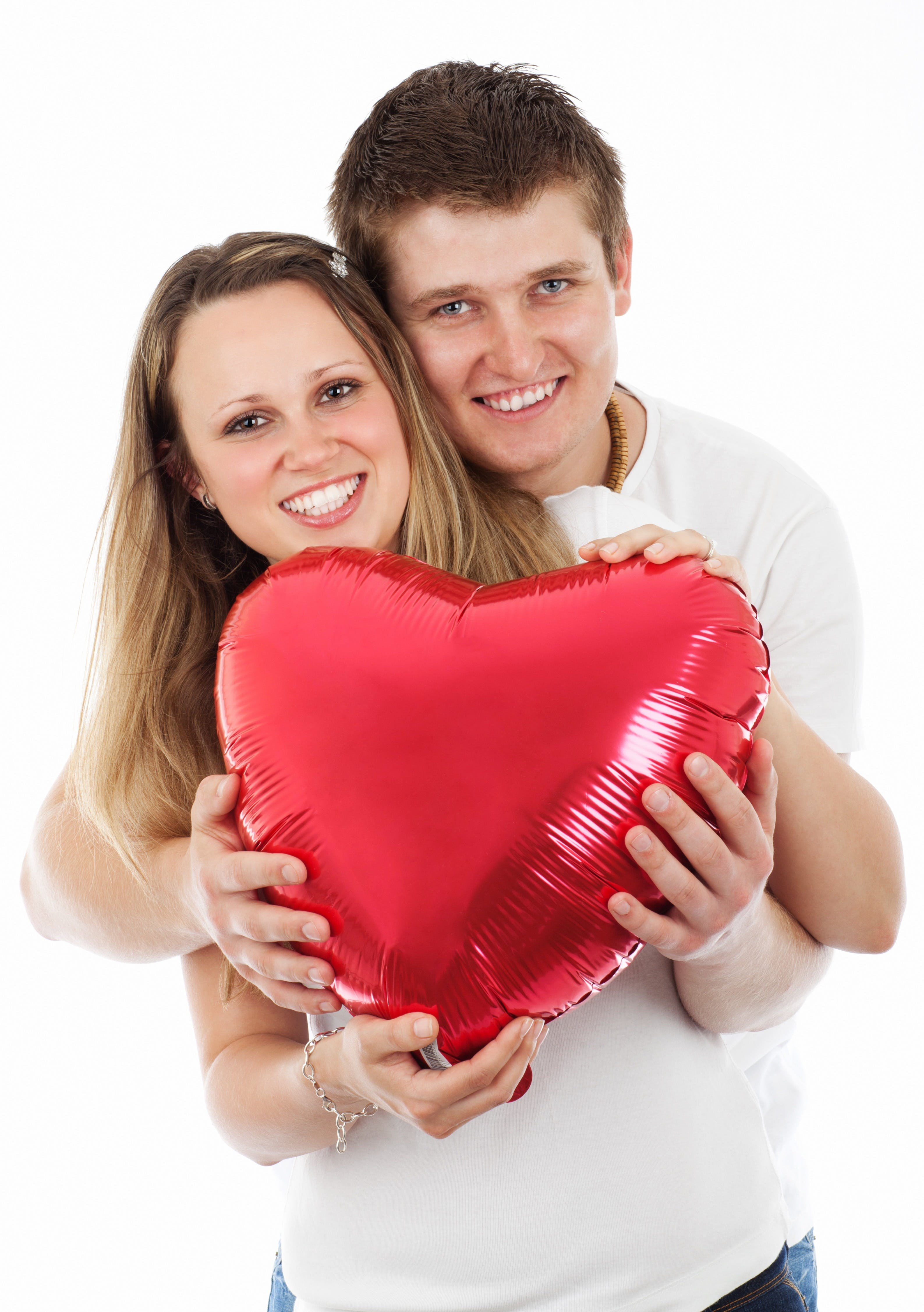Man and Woman Holding Inflatable Heart