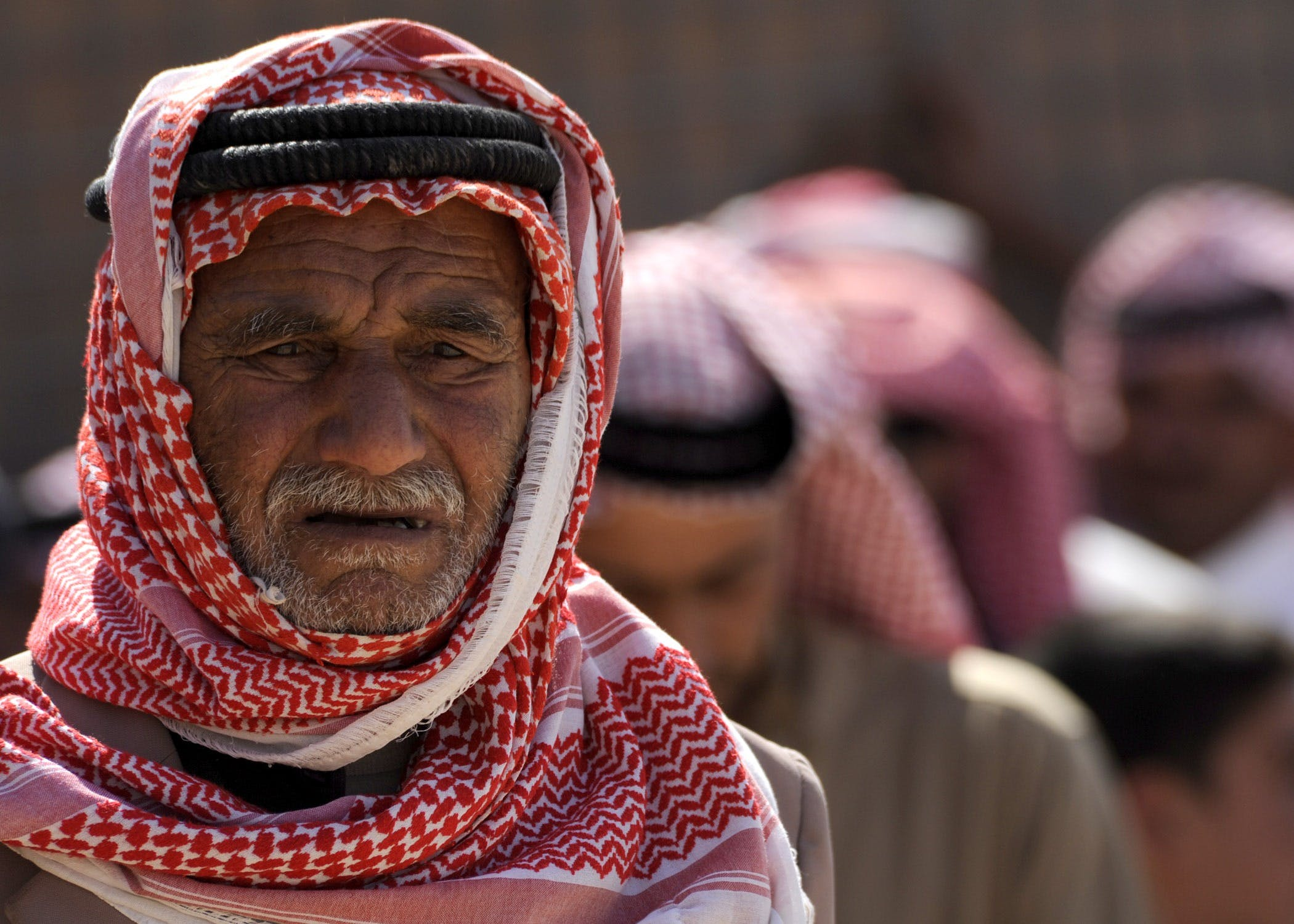 Man Wearing Red White Keffiyeh