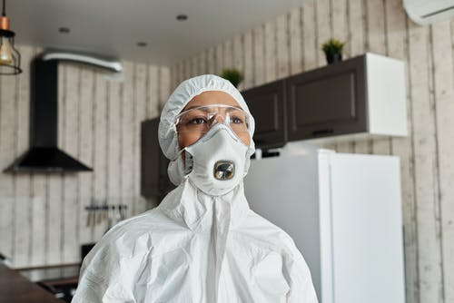 Person in A Protective Suit And Face Mask