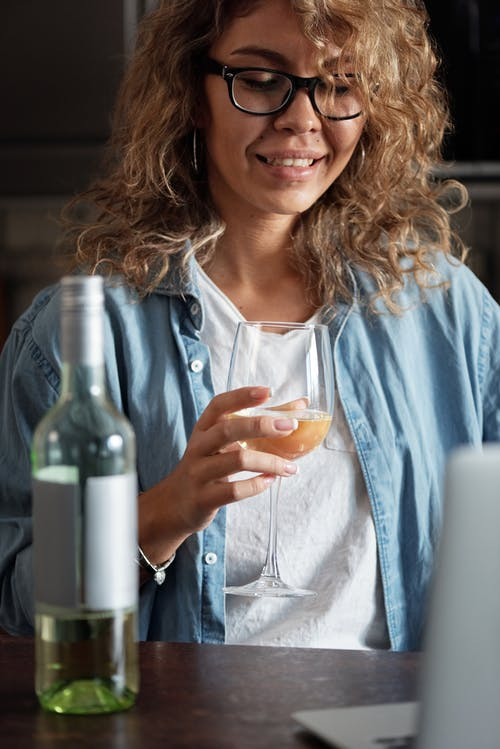 Photo Of Woman Drinking Alcoholic Beverage