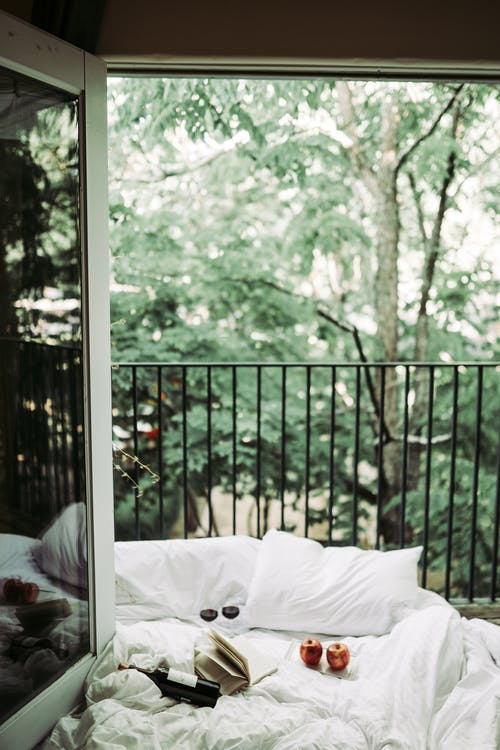 White Bed On The Balcony