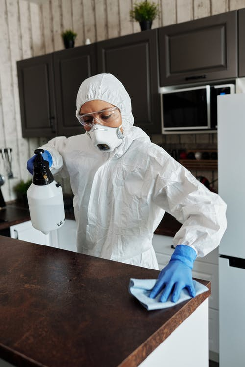 Photo Of Person Cleaning The Table
