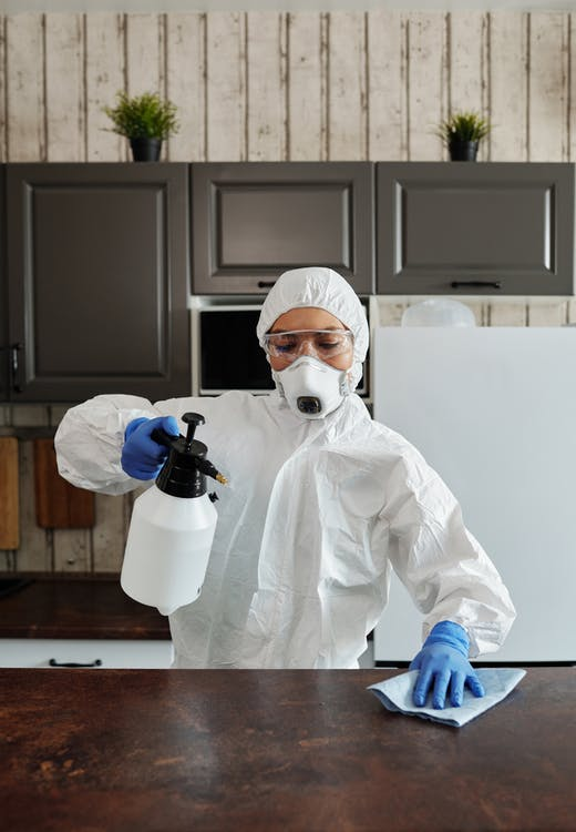 Photo Of Person Disinfecting The Table