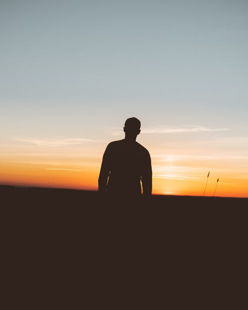 Silhouette Photo Of Person During Sunset