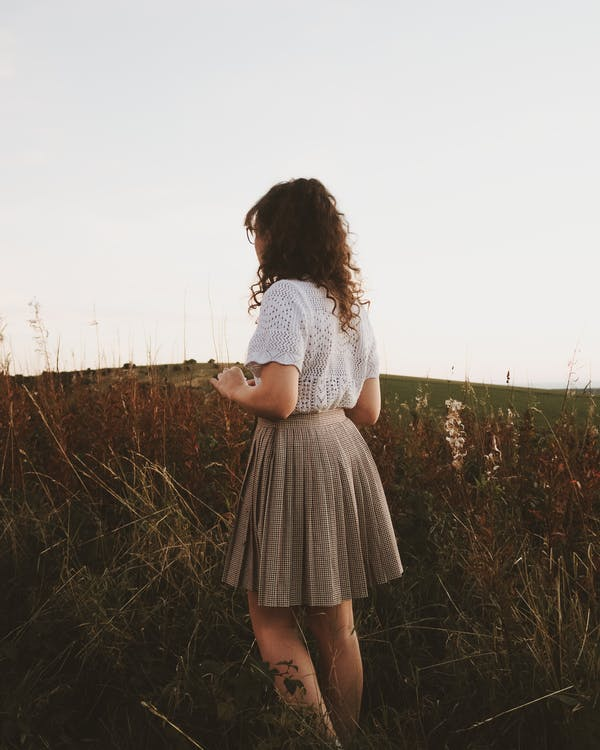 Photo Of Woman Standing on Grass